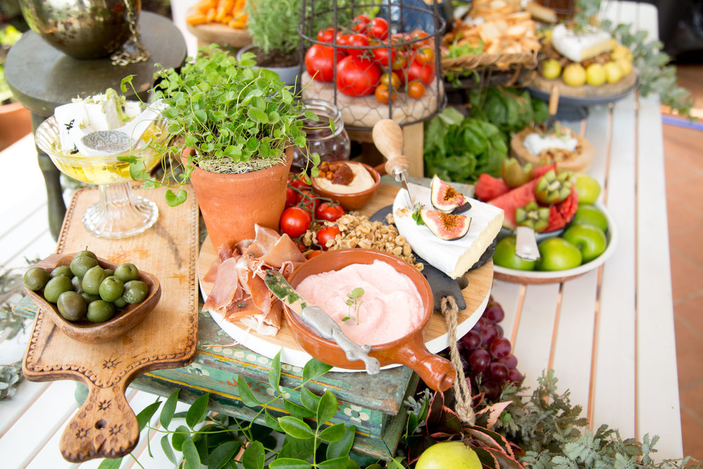Small dishes with dips, olives and nuts are filling nibbles to use on your grazing table