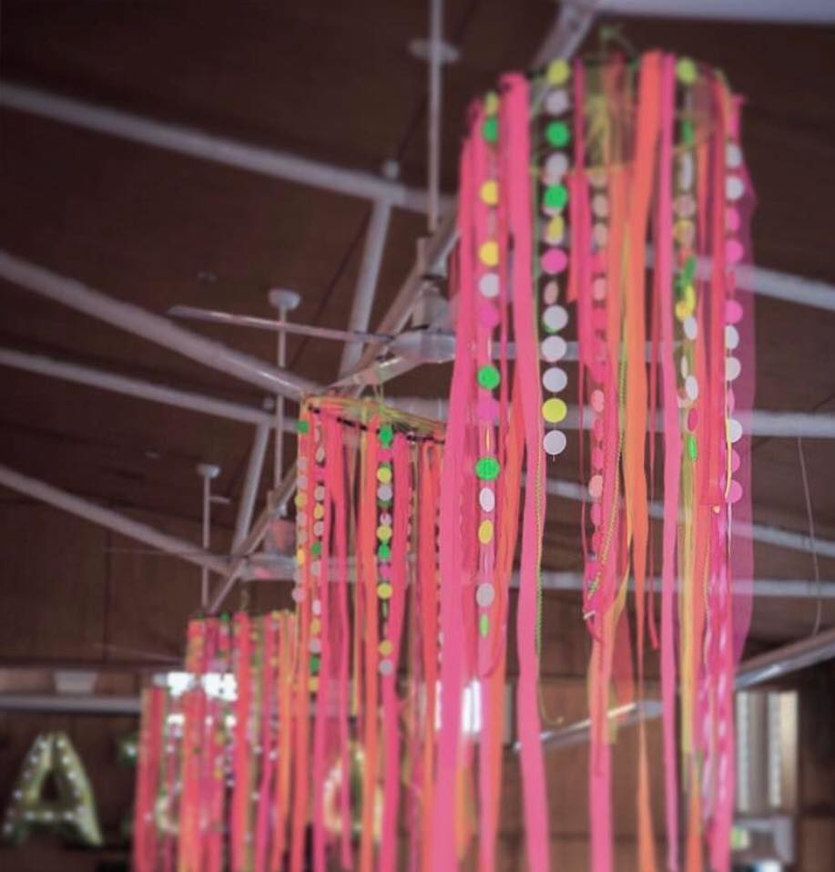 I made these neon paper chandeliers with strips of ribbon and paper using a hoola hoop.