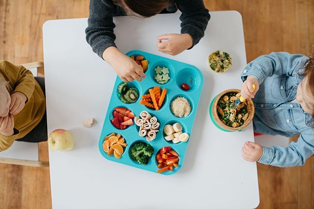 FUN FOOD FRIDAY 🥦🥕🍓 I was really excited about this series so I'm going to keep it up, despite having a little less time on my hands these days 👶🏼👧🏼 — Today for lunch we did a muffin tin meal (not as pretty as the one pictured ☝🏼). It was easy to prepare and a fun change of pace for my toddler who is needing some TLC right now. I recommend it as a fun way to introduce new foods and favorites side by side. — I got this idea from @veggiesandvirtue, and if you don't follow her you should! She has so many pearls of wisdom and fun ideas for feeding little ones. She fairly recently welcomed a third baby and has been a source of inspiration and encouragement for me during this pregnancy of how to juggle it all. Thanks Ashley 😘! . . #villagefunfoodfriday #funwithfood #villagenutritionco #letthembelittle #funfoodfriday #kidapproved #toddlerapproved #kidsinthekitchen #food52kids #cookingwithkids #toddleractivities #kidfriendlyfood #healthytoddlereats #eattherainbow