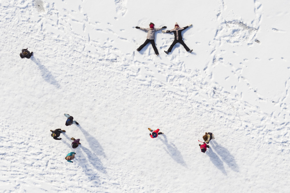 "Children play in the snow as people walk by on the frozen lake ""Lac de Joux"" after a series of cold days in Le Pont, Western Switzerland, Sunday, March 4, 2018. (KEYSTONE/Valentin Flauraud)"