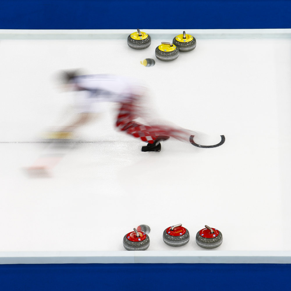 Norway's third Thomas Lovold delivers a stone during his game against U.S.A. at the World Men's Curling Championships in Cortina d'Ampezzo April 5, 2010. REUTERS/Valentin Flauraud (ITALY)