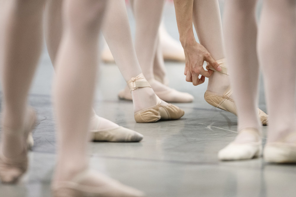 A dancer adjusts her ballet shoe as she attends a classical class during the third day of the 42th Prix de Lausanne in Lausanne, Switzerland, Wednesday, January 29, 2014. Launched in 1973, the Prix de Lausanne is an international dance competition for young dancers aged 15 to 18. Closing the six-day event, prizes are awarded to the best finalists consist in scholarships granting free tuition in a world-renowned dance school or dance company. (KEYSTONE/Valentin Flauraud)