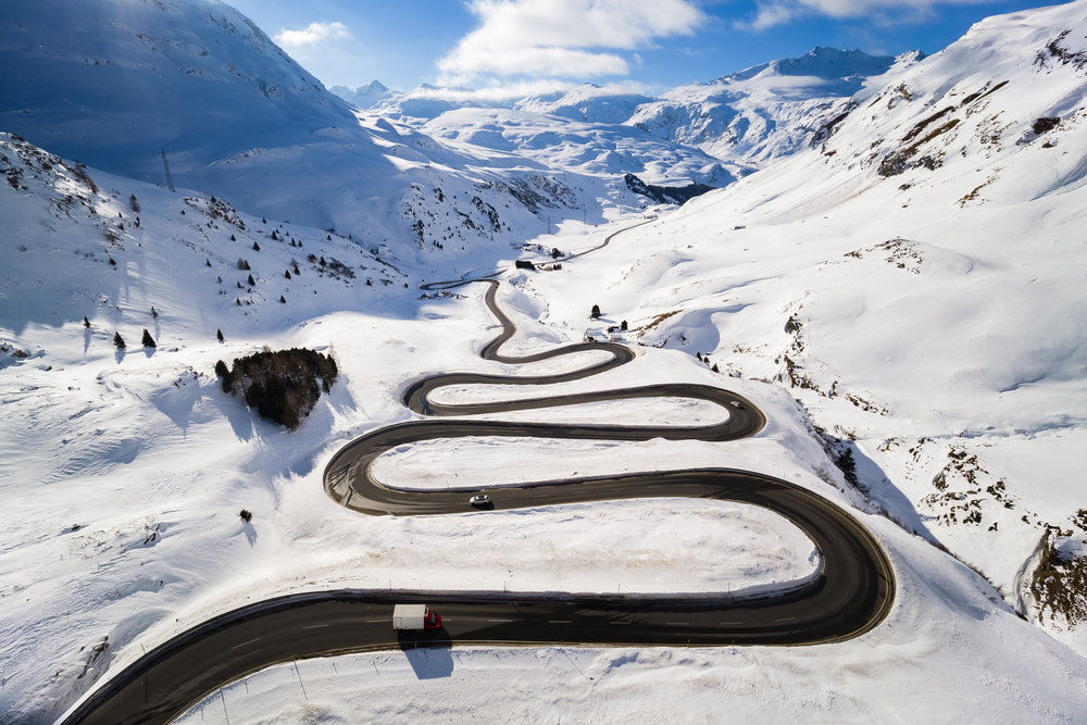 Steep turns on the winding road leading up to the Julierpass that connects the Engadin valley to the rest of the canton of Graubuenden are pictured in Bivio, Switzerland, Thursday, January 24, 2019. (KEYSTONE/Valentin Flauraud)