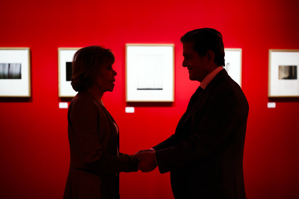 """Collectors Sondra Gilman, left, and Celso Gonzalez-Fallaa, right, hold hands as they pose for a portrait at the exhibition """"The Beauty of Lines"""" from the Gilman & Gonzalez-Falla collection at the museum of photography Musee de l'Elysee in Lausanne, Switzerland, Tuesday, January 30, 2018. Considered one of the ten most important private photography collections in the world, this American collection is presented for the first time in Europe. (KEYSTONE/Valentin Flauraud)"""