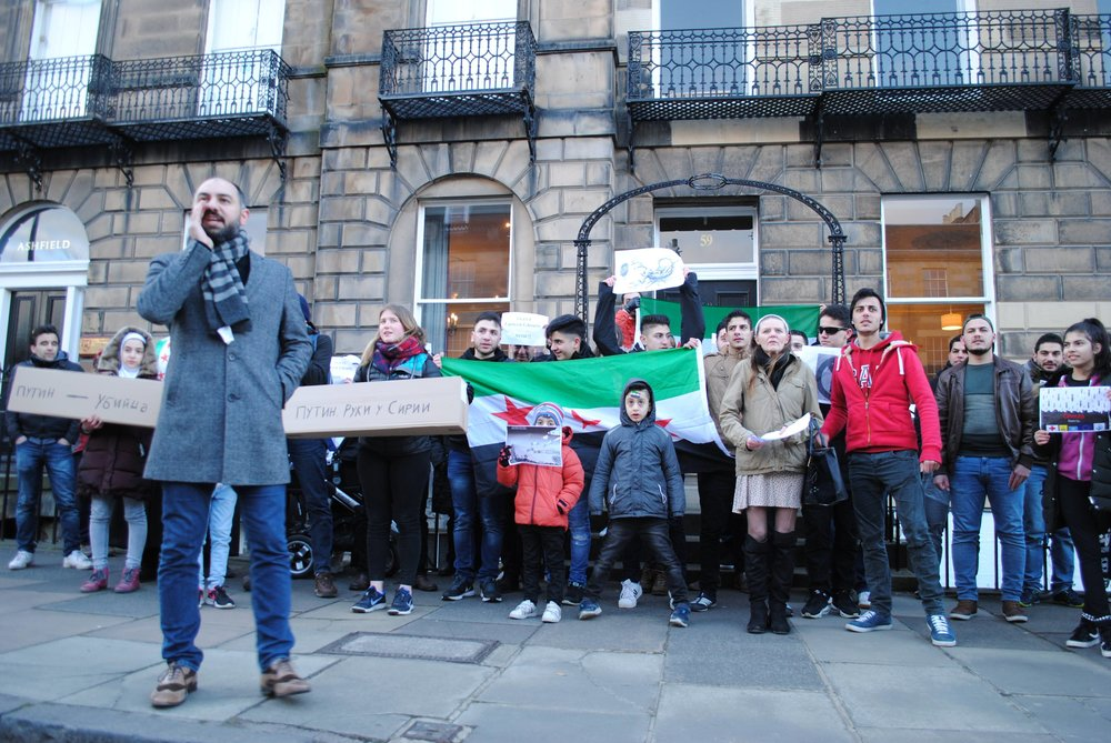 A large group of protesters lead by Syrian refugees gathered outside the Russian consulate in Edinburgh  Photo by Ross Cowper-Fraser