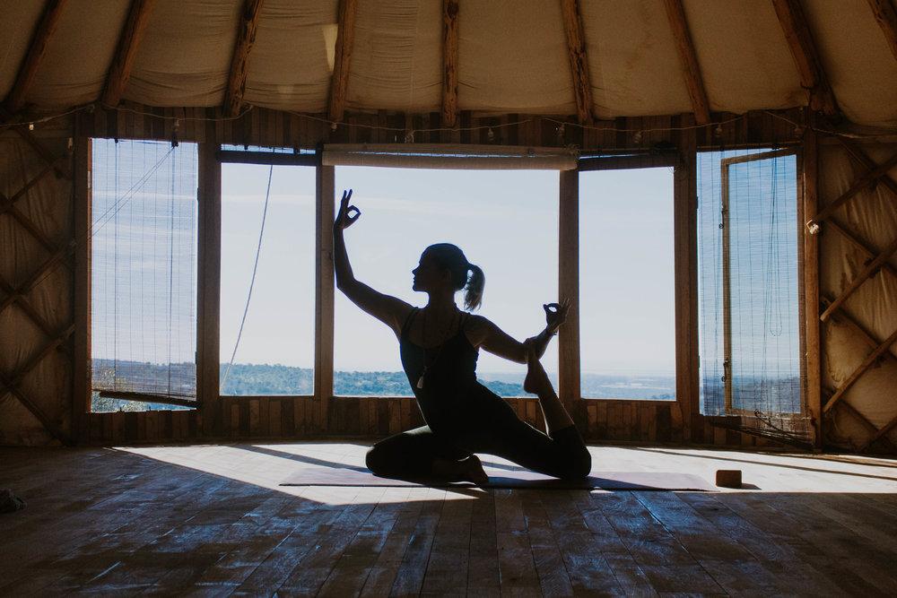 Sanne doing yoga in the yurt.jpg