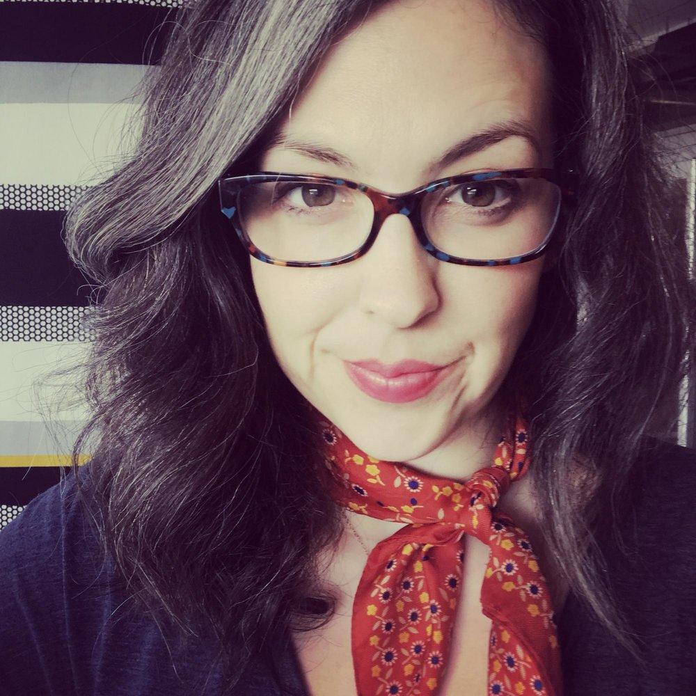 woman-wearing-red-bandana-around-her-neck.jpg