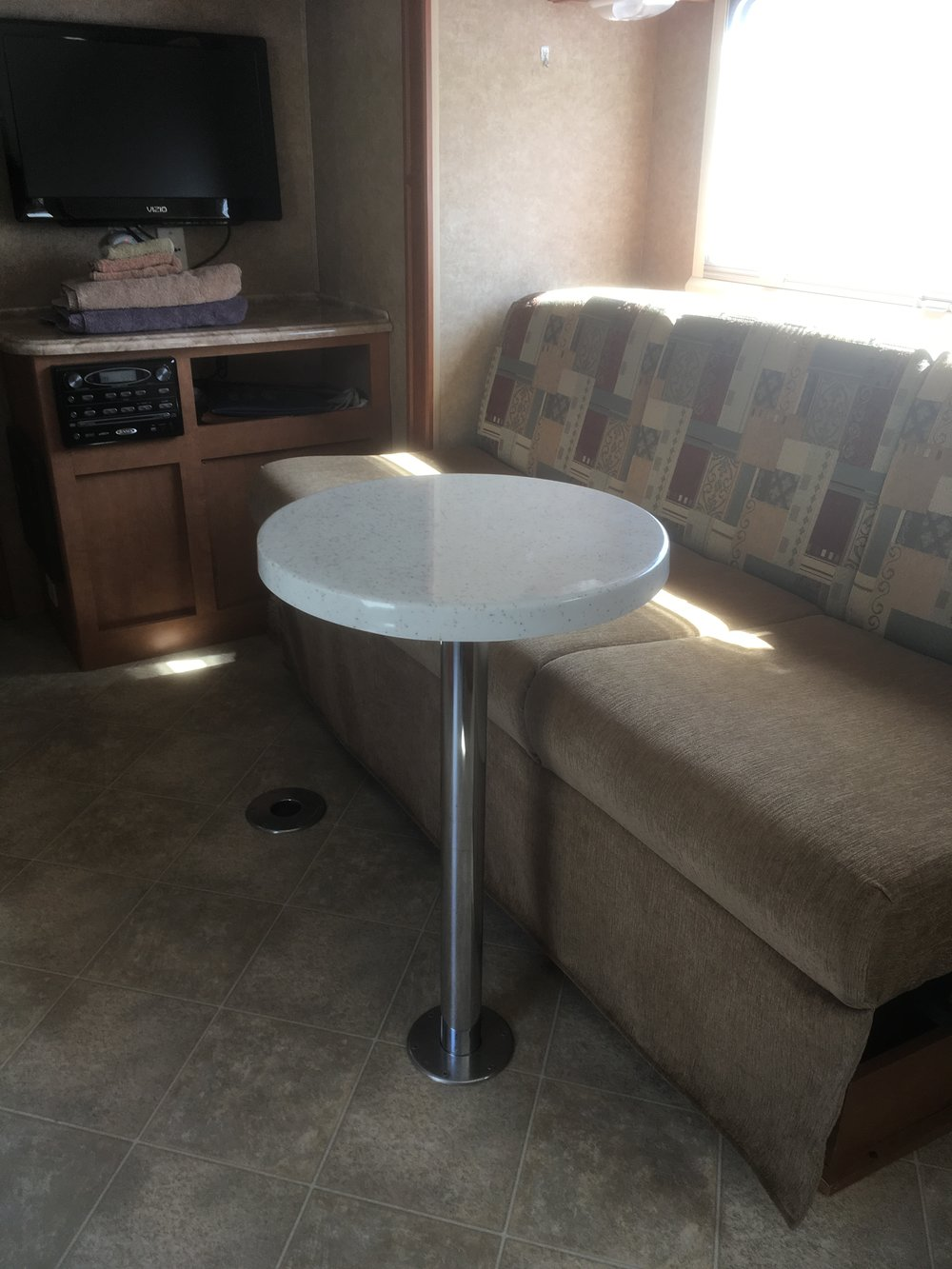 The Original RV Cafe Table saves space! Move easily around our table and enjoy your couch or dinette seating in greater comfort. Color may vary slightly from what is pictured here.