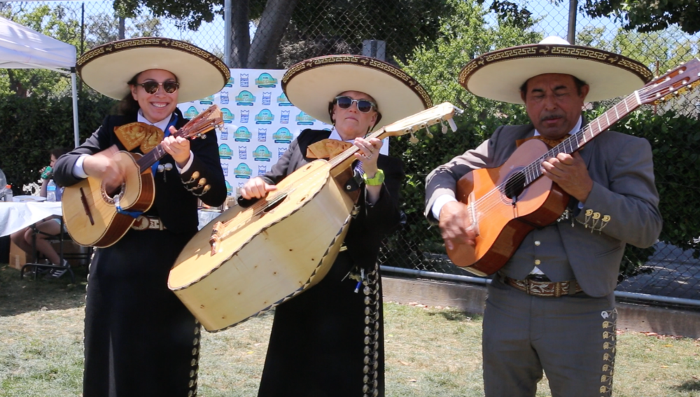 Mariachi Singers At Lunch - During the lunch break, a taco vendor provided food. There were also mariachi singers that came and performed for the players. After lunch, the silver and gold brackets began. The top 8 teams made it into the gold bracket, meanwhile everyone else was in the silver one. In both brackets, if you lost a game, you were out. The games were long and intense, but in the end, a team from Colorado won it all.Joss Rogers made all the trophies. He made first, second, and third place award for both brackets. He also helped with the participation awards, which were little kubb pieces.The tournament was a huge success. I played on a team and it was really fun. Kubb is a strategic game that more people should play!