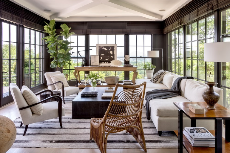 Source  Designer Betsy Brown's use of black is countered with loads of natural light and carefully selected furnishings, finishes and accessories.