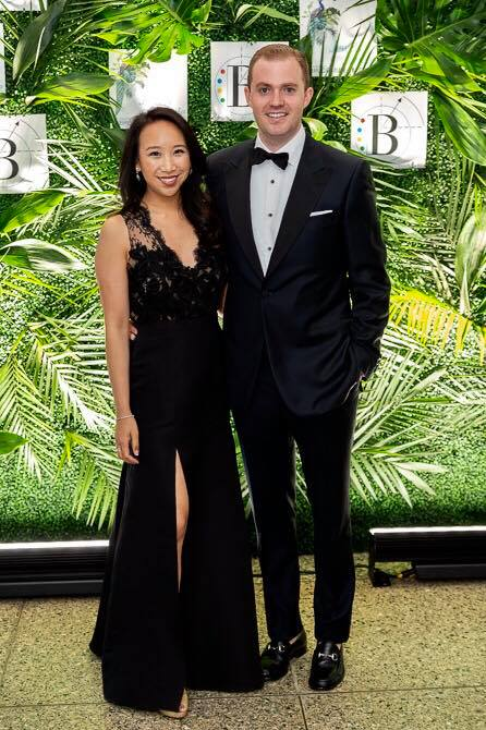 In a custom all black embroidered lace top and silk faille fit and flare skirt. My husband Owen wore a Saville Row midnight navy tux.