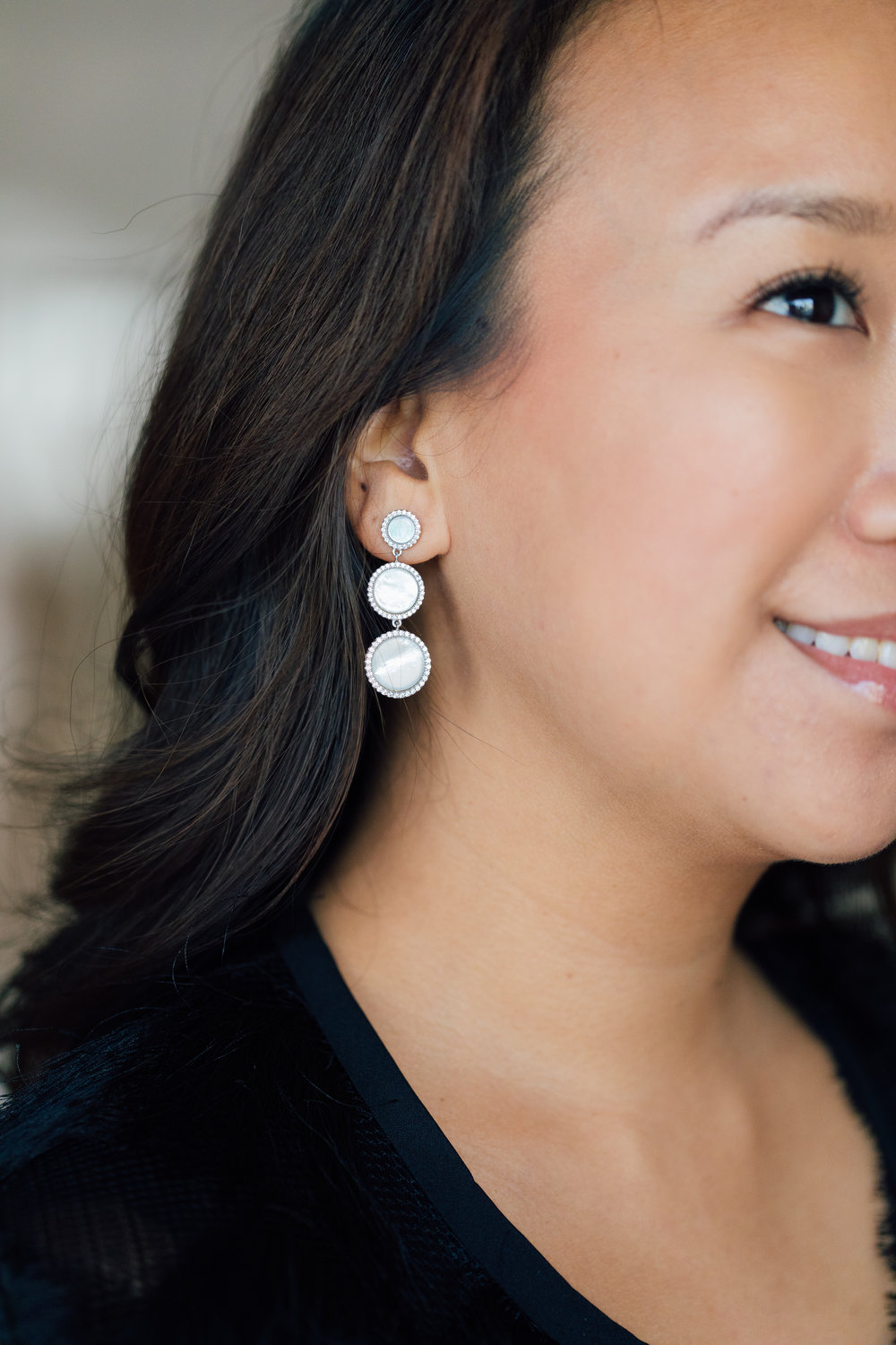... and Nyla Star's 3-tiered Mother-of-Pearl earrings are sure to complement any outfit!