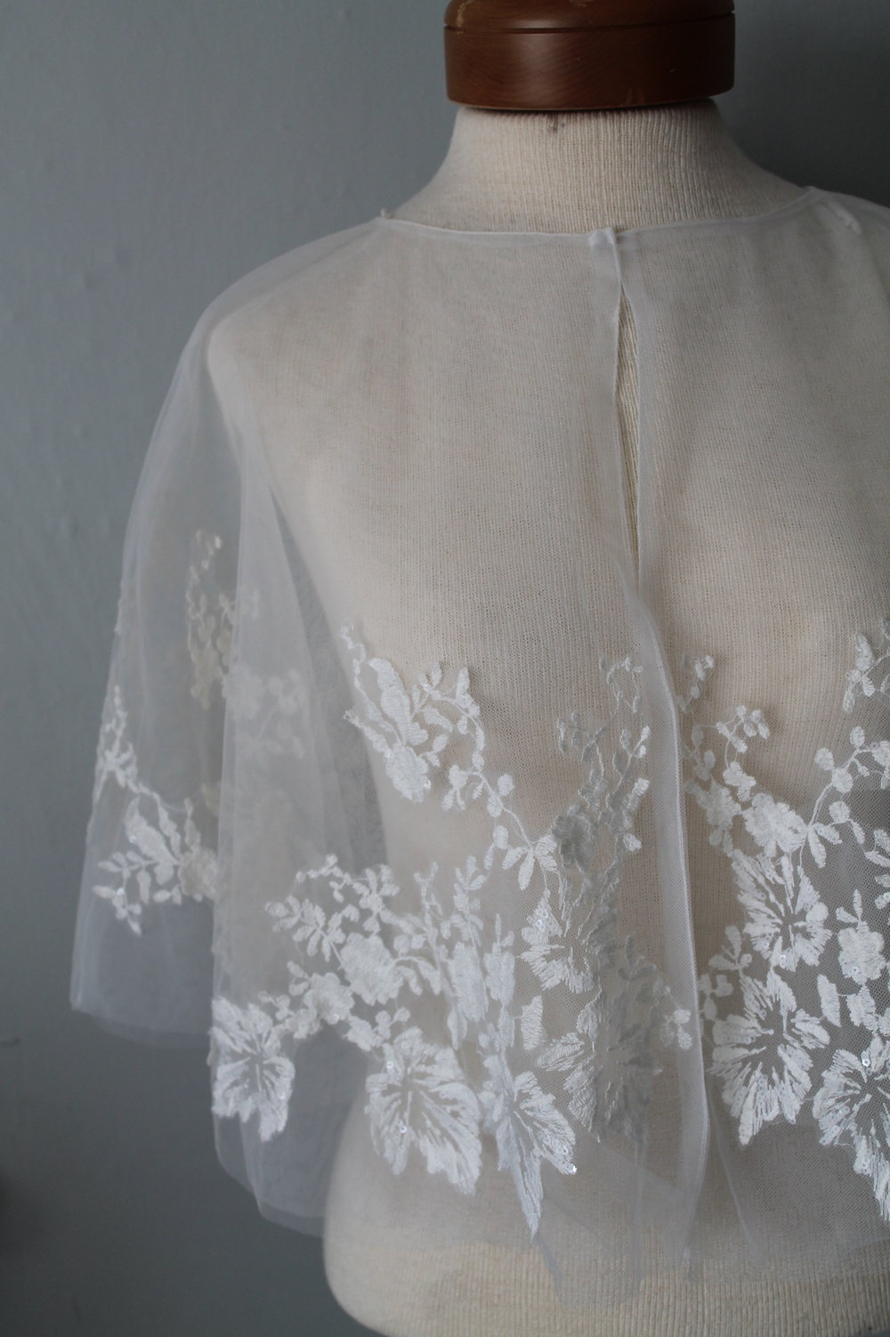 Ivory Tulle Capelet with Lace appliqueSize: All 25.00 -
