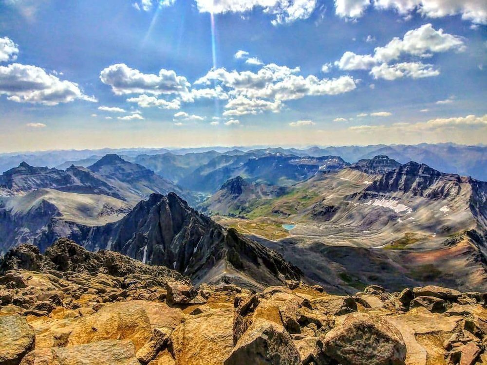 At the summit of Mount Sneffels near Ouray, Colorado, taken by my friend, Lee Nemes.
