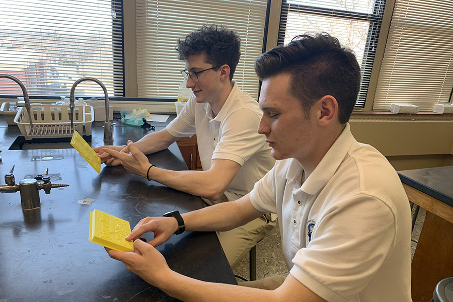 Teaching shapes to blind young students, by Mount St. Mary's students