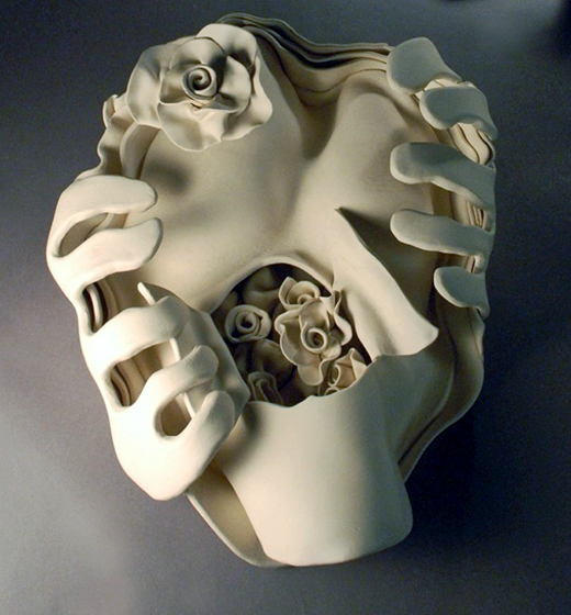"Ektoskeletal Torso- lg. open heart w.roses 2011 porcelain 18 x 12 x 6""   My intent now being to synthesize the mediums, themes and images that have pervaded my lifetime of making art, to get to the essence, to the skin and bones of my vision, both literally and figuratively. Thus, at my NY residency, I created white porcelain bonelike ""Ektoskeletal Torsos,"" which developed into painted torsos in 2012."