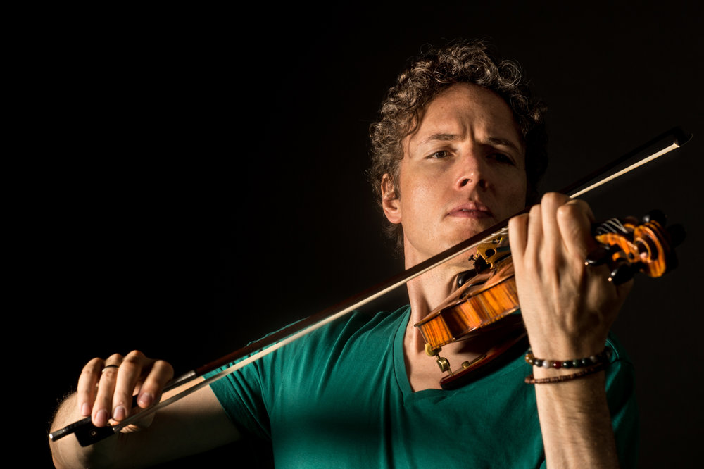 For more information on violin soloist Timothy Fain,  visit his website . Photo credit: Michael Weintrob