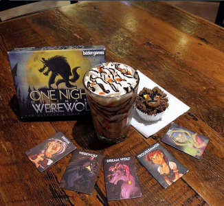 Game-themed food and drink items are often on their menus, like this One Night Ultimate Werewolf cupcake and iced latte.
