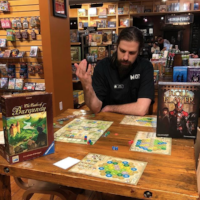 mox boarding house board game cafe guest playing a game.png