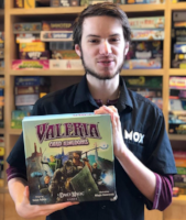 mox boarding house board game cafe staff excited about valeria card kingdoms game.png