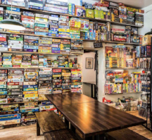the uncommons board game cafe board game wall selection