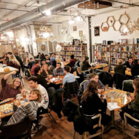 tabletop board game cafe interior guests playing games