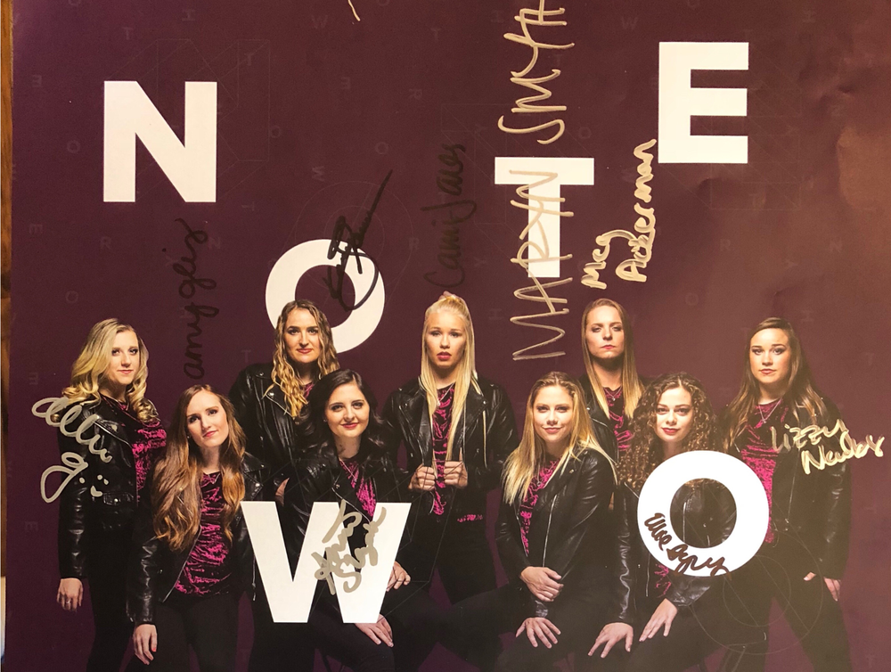 Autographed poster of noteworthy. Members include Allie, Amy, Kacey, Anna, Cami, Maryn, Megan, Ellie, and Lizzy.