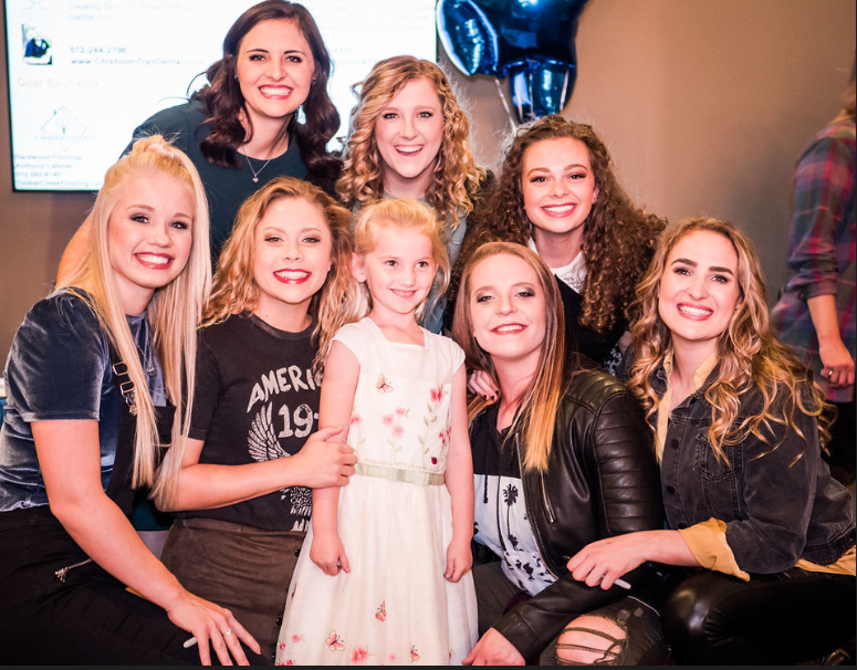 """""""I love this picture. I think that  this is really what the night was all about . These young girls are making Noteworthy singers their heroes instead of Britney Spears and that is priceless! I have a five year old daughter and I hope she picks the Noteworthy girls as her role models."""" - Joseph Fluckiger, Austin BYU Alumni"""