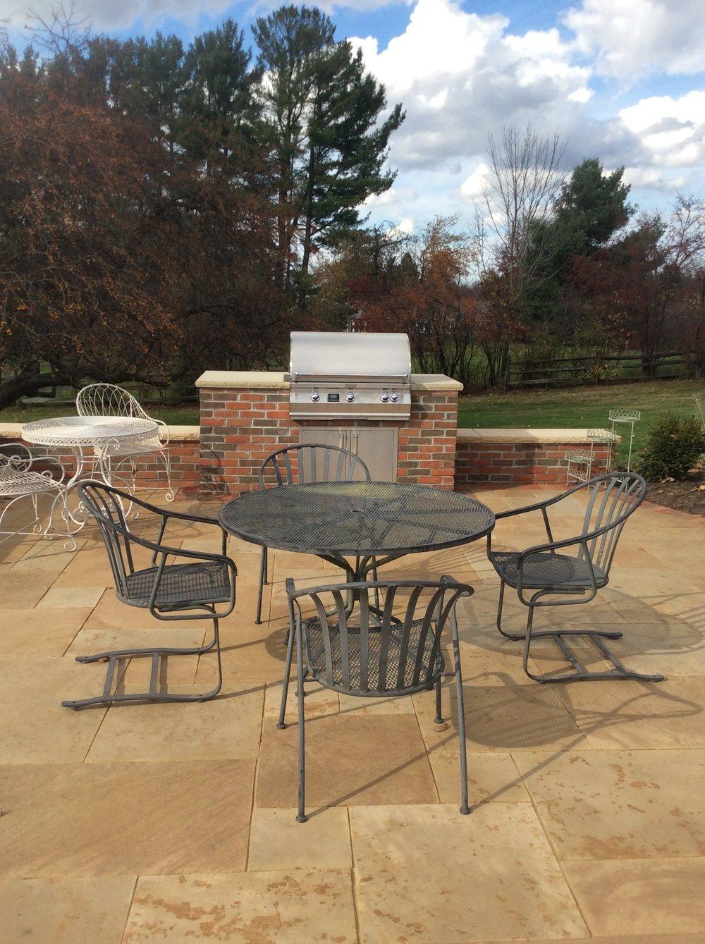 Landscape design with Unilock patio pavers in Bainbridge Township, OH