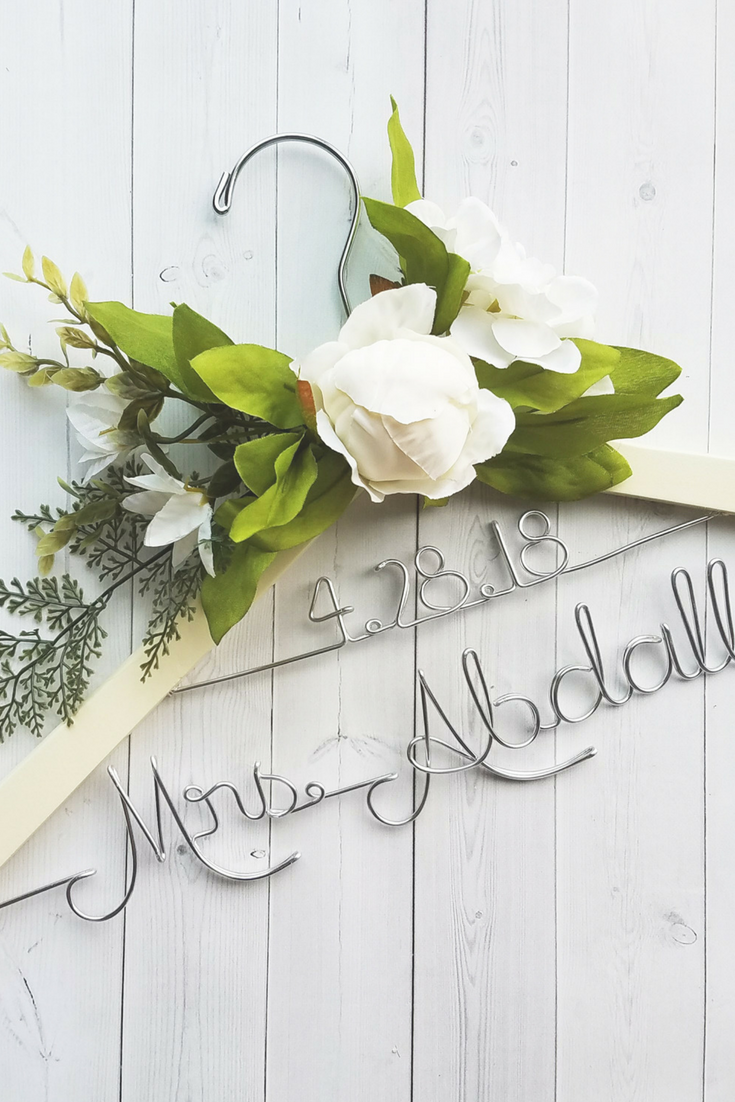Wedding Hanger With Date and White Flowers.png