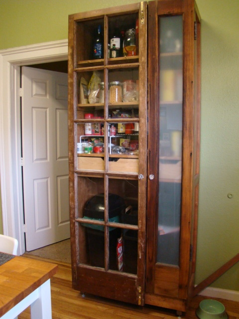 Reclaimed pine and recycled door pantry cabinet