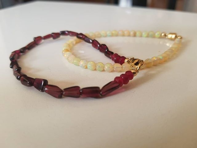 I love mixing and matching different gemstones. This Opal bracelet pairs nicely with January's birthstone Garnet. What do you think?  #opalbracelet #garnetbracelet #gemstonejewelry #handmadejewelry #beadedbracelets #beadsarefashion #whatsinyourjewelbox