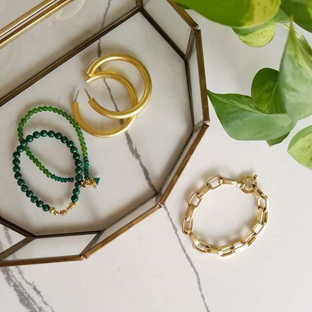 A few jewel box favorites. Malachite and jade beads with gold link bracelet on the arm + must have large hoops = pretty Spring accessories that compliment any outfit.  #beadsarefashion