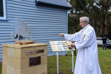 Emeritus Archbishop Adrian Doyle blessing the memorial .