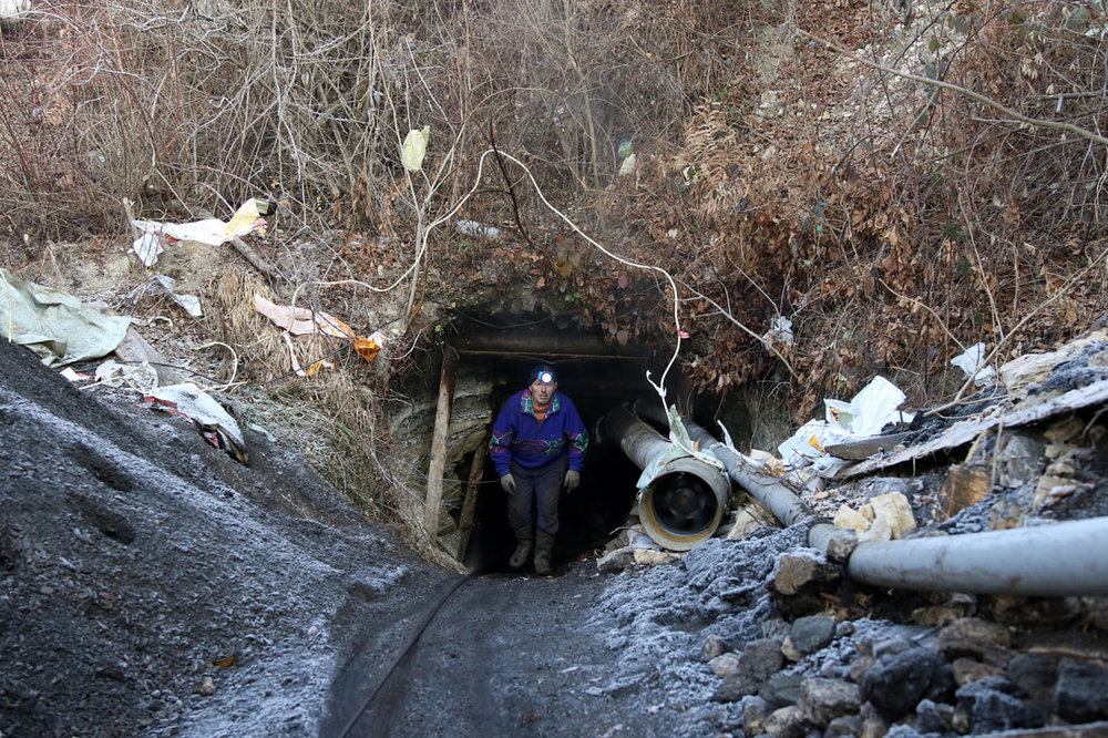 December 11, 2016, Kozarci - Illegal miners are seen exiting a mine. Miners work with makeshift tools and dig out coal from illegal mines earning 20KM a day, and digging out about 40 tons of coal.