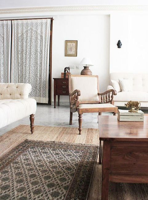 """This space was decorated with furniture sourced from Delhi or made in-house. Its tones and upholstery were made to match the existing wall color which could not be repainted."" - Shivani"