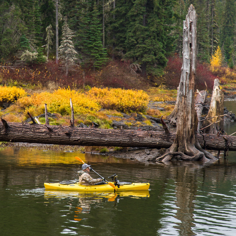 Kayaker and fall colors at Goose Lake