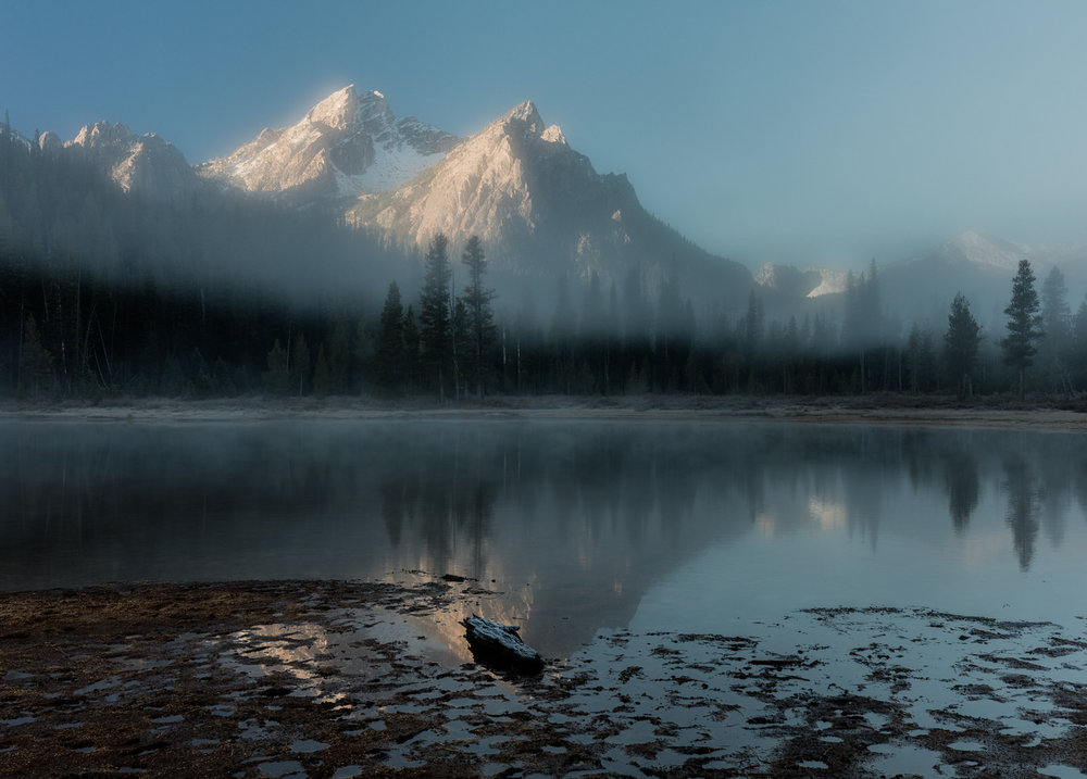 Mt. McGowan appears through the fog on a fall morning near Stanley Lake