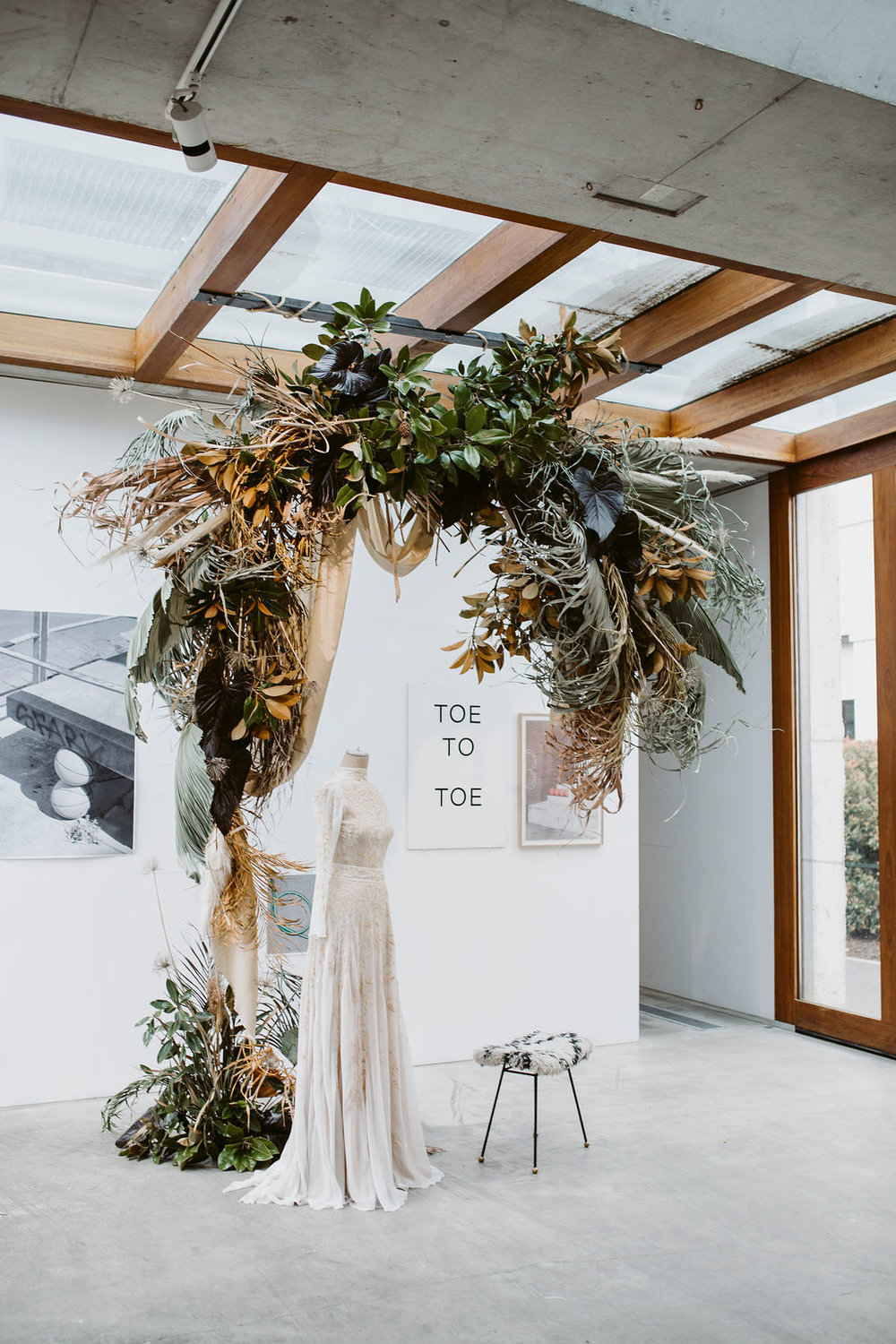 MOXOM AND WHITNEY   The dream weavers a.k.a. Moxom + Whitney were the creative visionaries behind the amazing foliage installations at our pop up recently at the Nishi Gallery, Canberra (as seen above). Let Lou Lou and her team loose on your wedding floral dreams and be prepared to loose your mind!