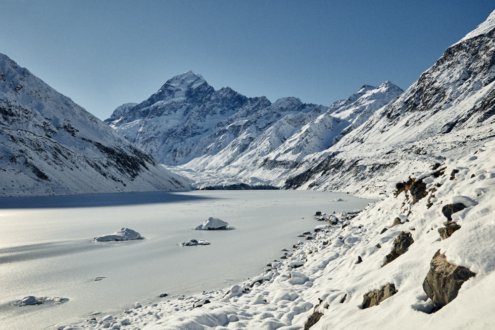 Hooker Lake at the head of Hooker Glacier under Aoraki/Mt Cook together with icebergs frozen for winter
