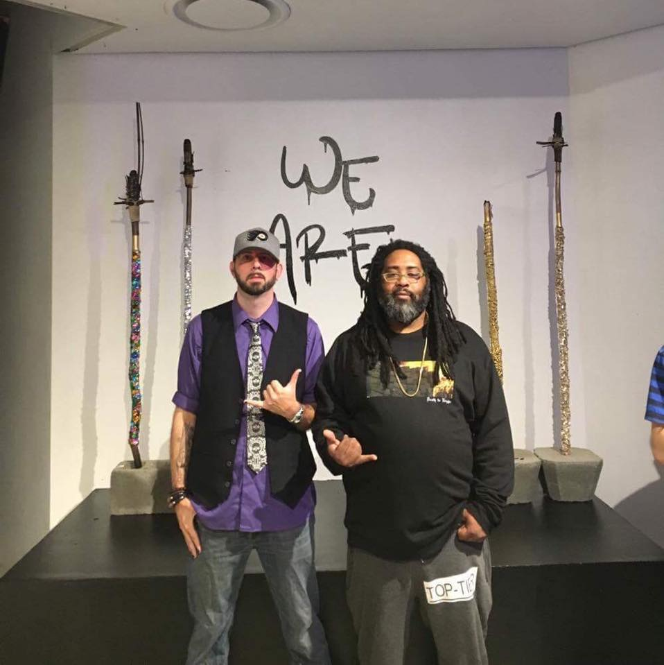 Norristown Swag , 2017, Instillation of bamboo torches, cotton rope, and beads. -The rap duo Blaq N' Nappy posing in front of artist, Ciara Newton's installation titled White People N' Tiki Torches .