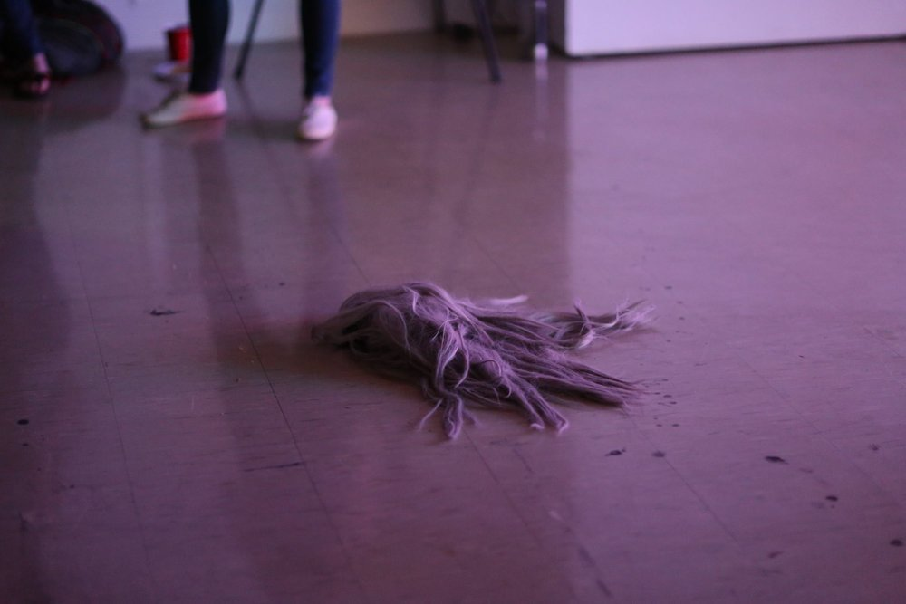Leave No Wig Behind , 2017, Instillation of monofilament. -Post performance, a fallen wig becomes a works of its own. Taken During Closing Reception.