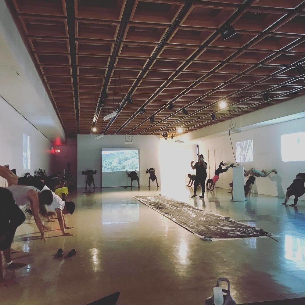 Round of Applause, 2017, Performance on gallery walls. -A day before the closing reception, artist Ciara Newton leads a group of collaborators through the steps of wall twerking.