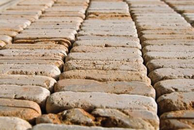 Pavimenti e rivestimenti esterni in tozzetti di pietra