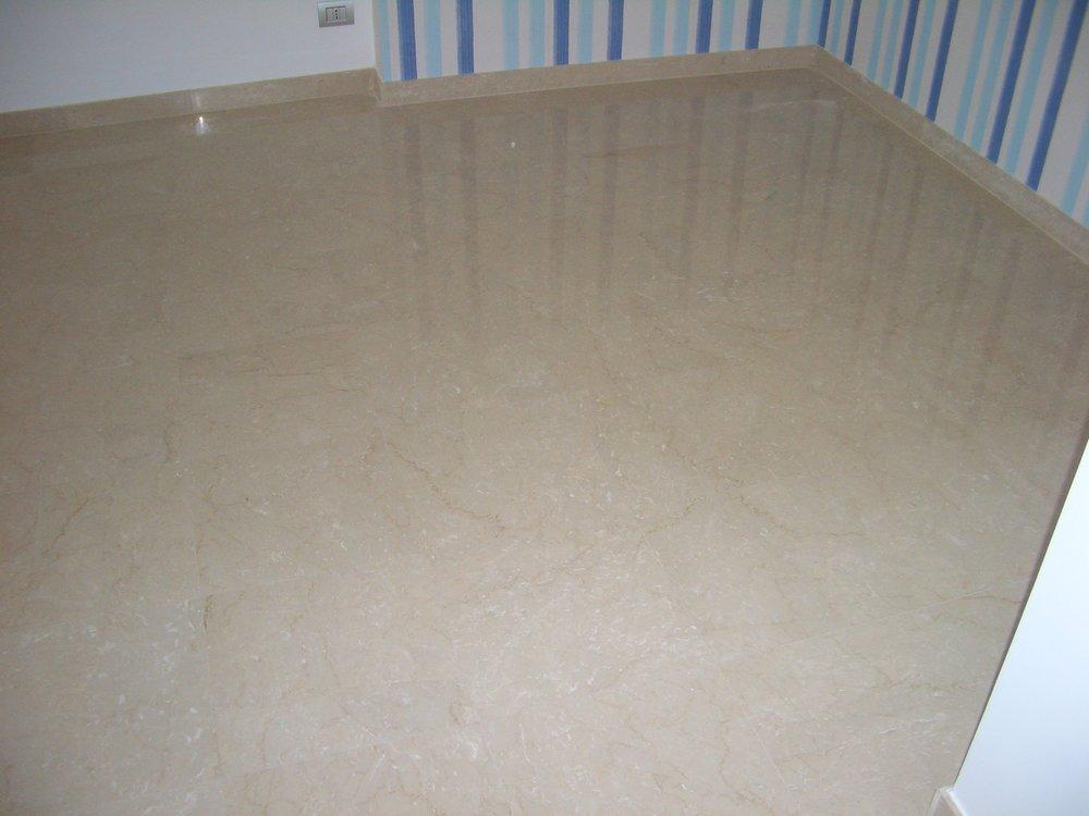 Pavimento in marmo Botticino classico