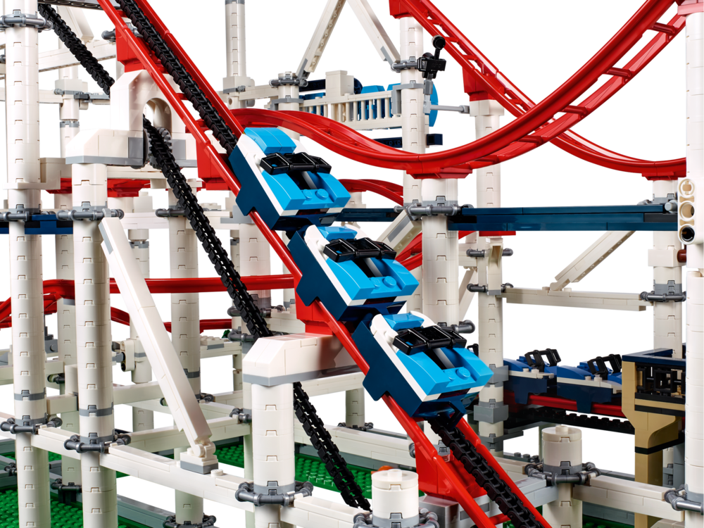 Fully functional chain-lift Roller Coaster model features a classic brick-built sign, control panel, 2 trains—each consisting of 3 train cars with low-friction wheels, and a 44-piece track consisting of 7 different rail elements.