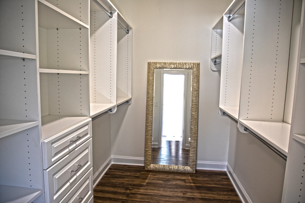 Walk-in Master Closet with ExtensiveCloset Organizer. Solid-Core Interior Doors. -