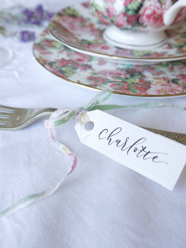 Place settings - For adding finishing touches full of charm to your table settings these calligraphy name tags work wonders. They look lovely if you're hosting a formal dinner or afternoon tea party. They're sure to please and can be taken home by your guests and treasured as a reminder.