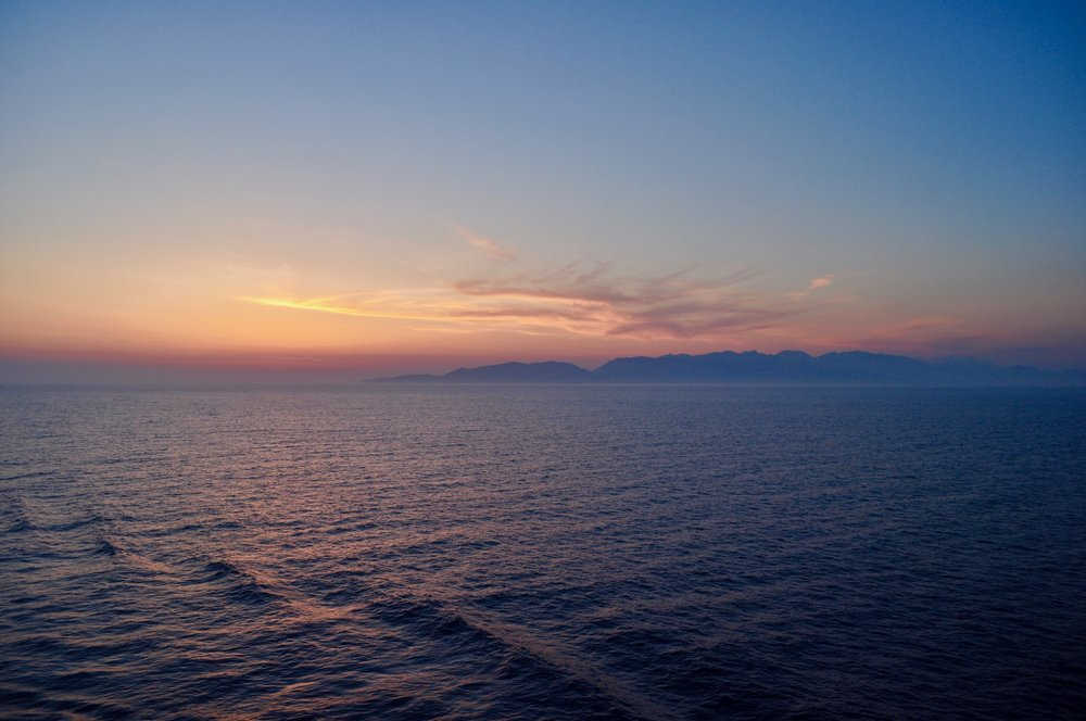 Exploring the Greek Isles on a Cruise - A Happy Passport #greece #cruise #sunset