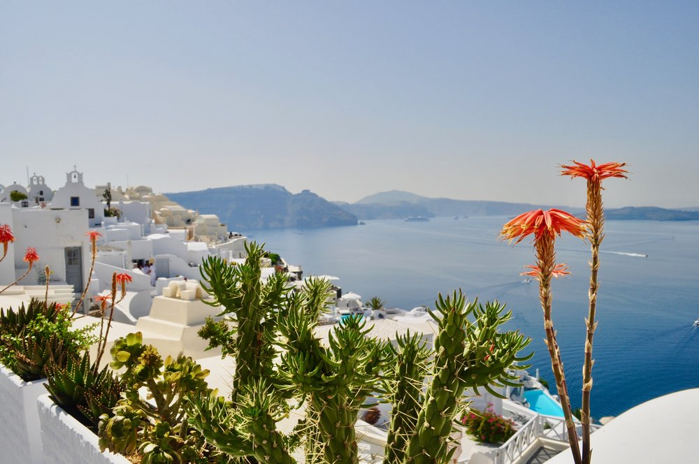 Exploring the Greek Isles on a Cruise - A Happy Passport #greece #oia #cruise #santorini